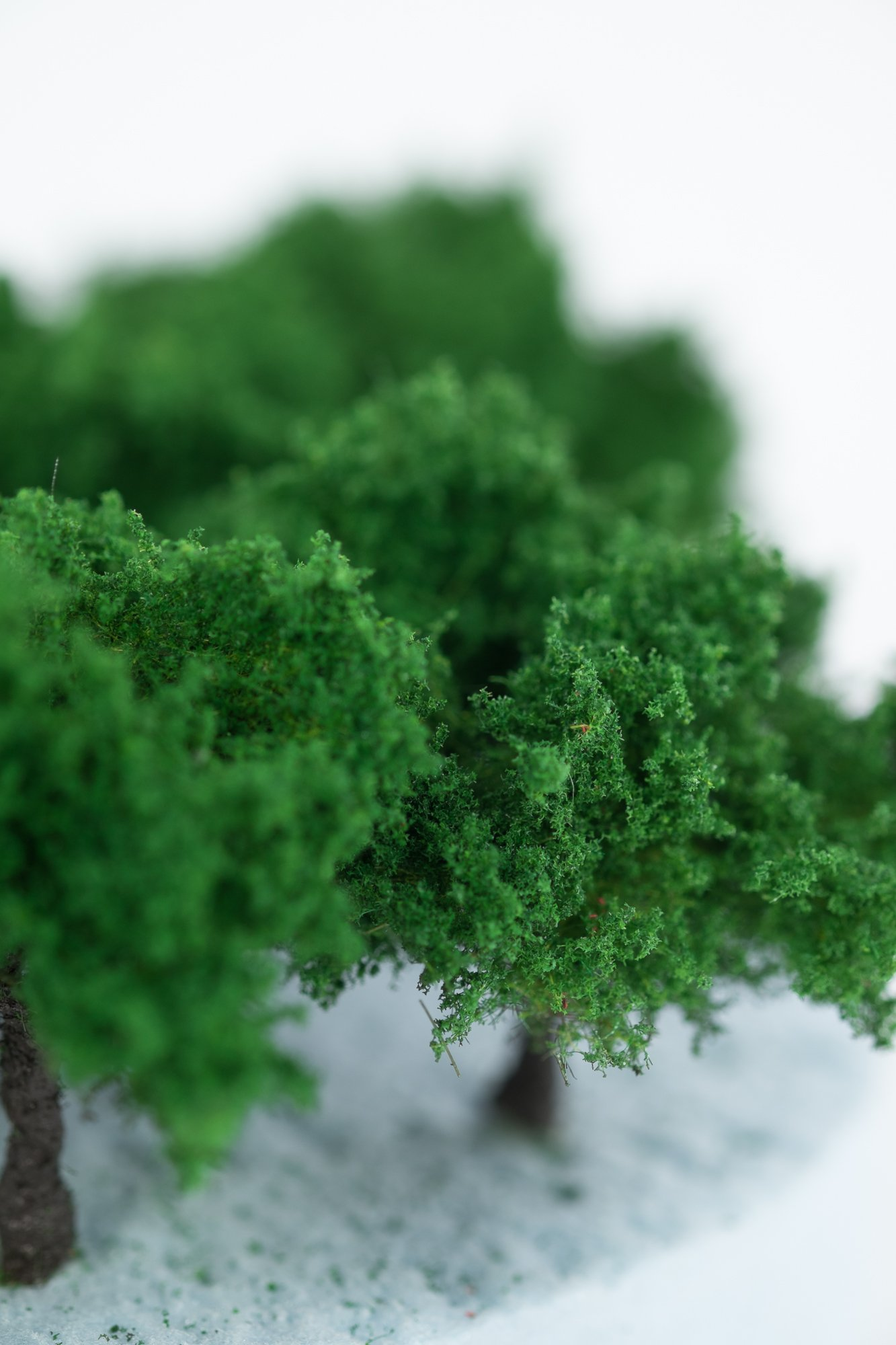 Closeup of foliage on regular dark green model bushes. Made from high quality model supplies by Primo Models.