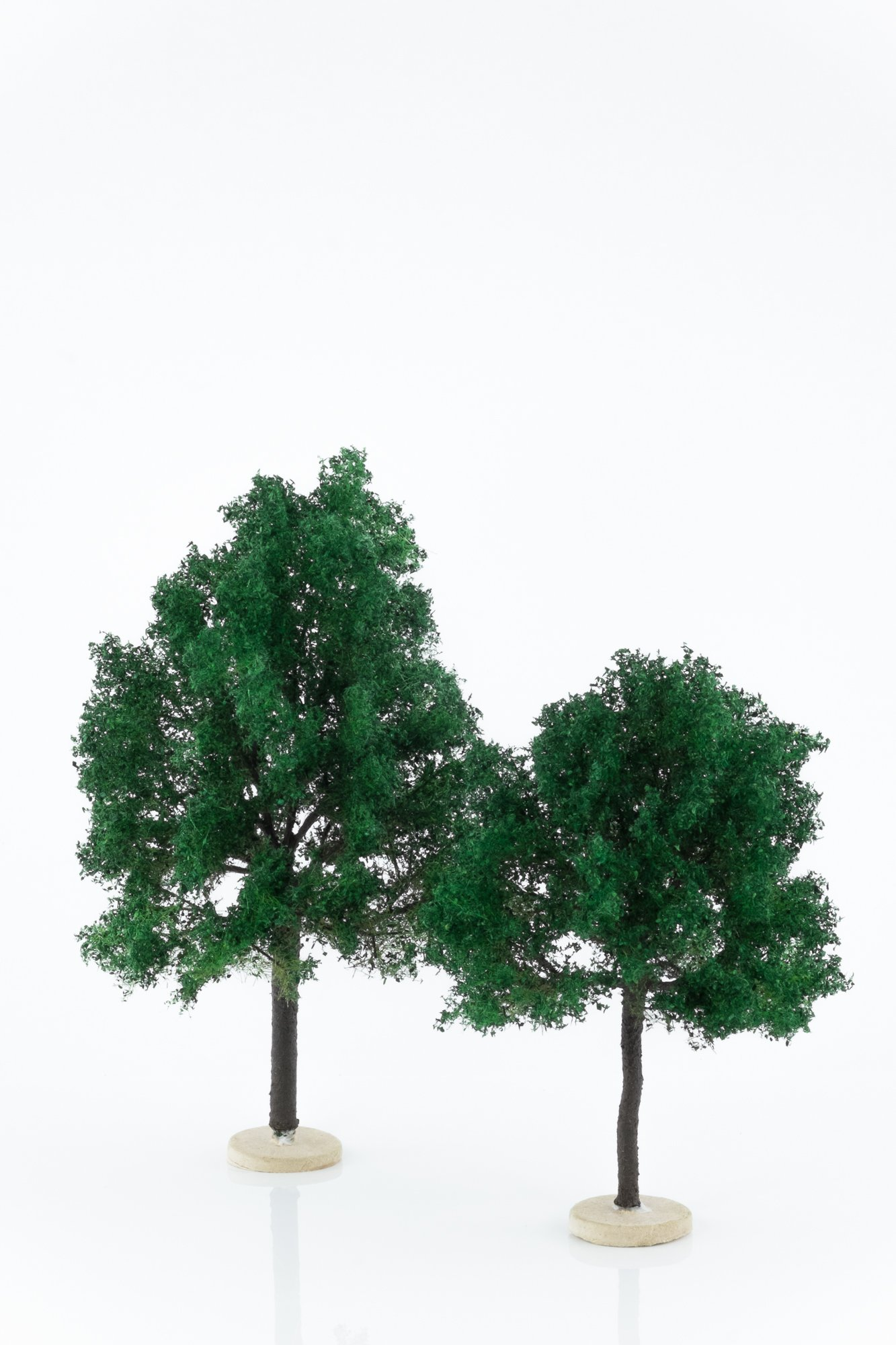 Two, green, chestnut model trees. Size from 14 to 20 cm. Made from high quality model supplies by Primo Models.