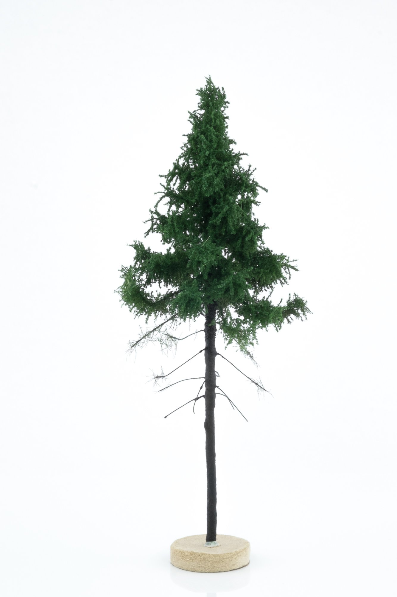 Hand-made, green, forest spruce tree model. Size between 18 and 20 cm. Made from high quality model supplies by Primo Models.