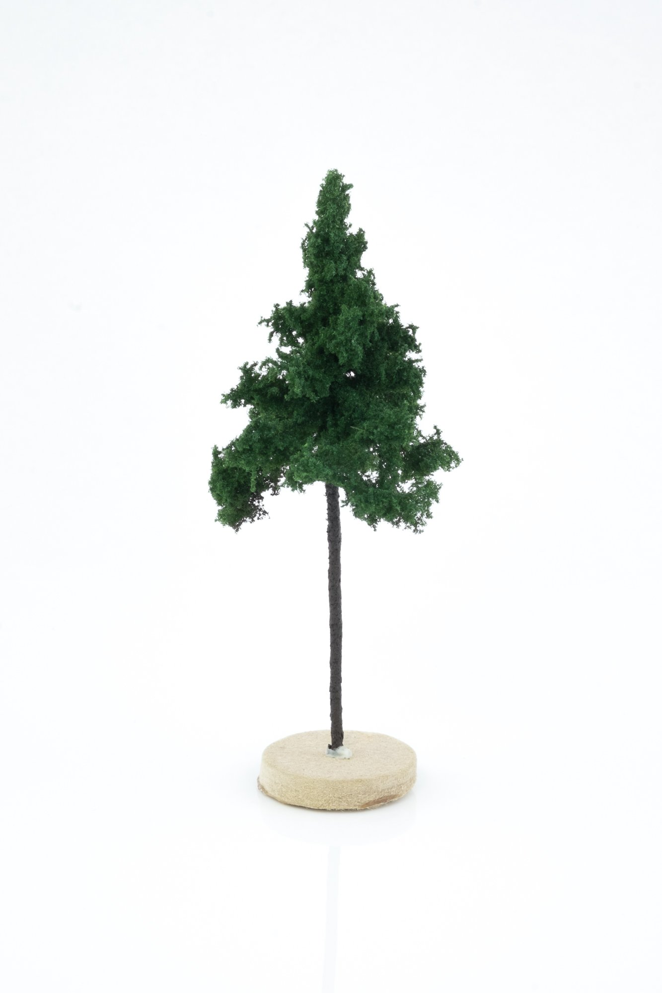 Hand-made, green, forest spruce tree model. Size between 8 and 12 cm. Made from high quality model supplies by Primo Models.