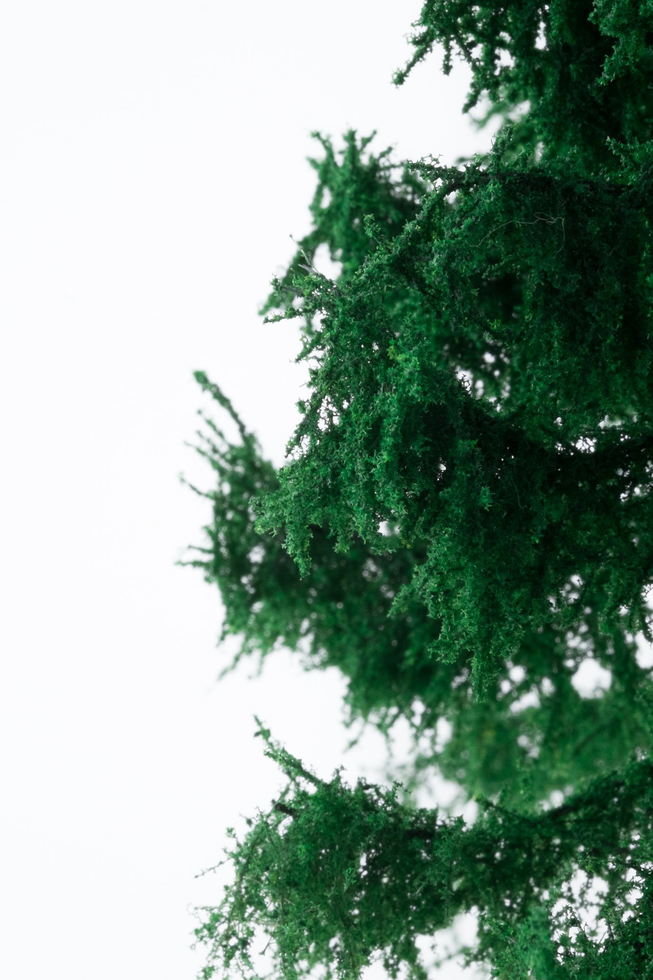 Closeup of foliage on forest spruce tree model. Made from high quality model supplies by Primo Models.