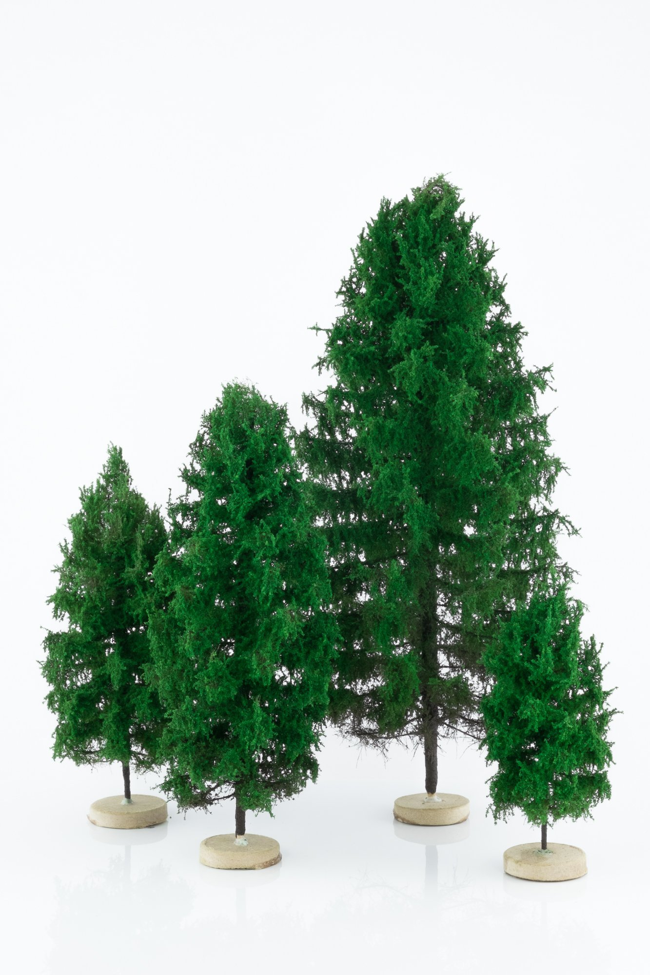 Four, green, larch model trees. Size from 8 to 28 cm. Made from high quality model supplies by Primo Models.
