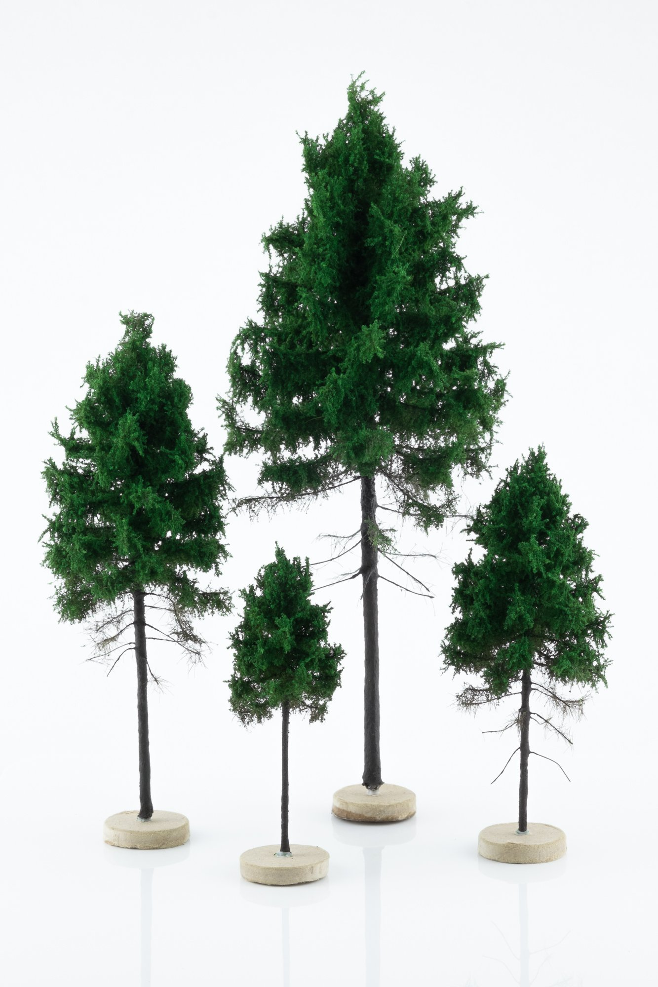 Four, green, forest larch model trees. Size from 8 to 28 cm. Made from high quality model supplies by Primo Models.