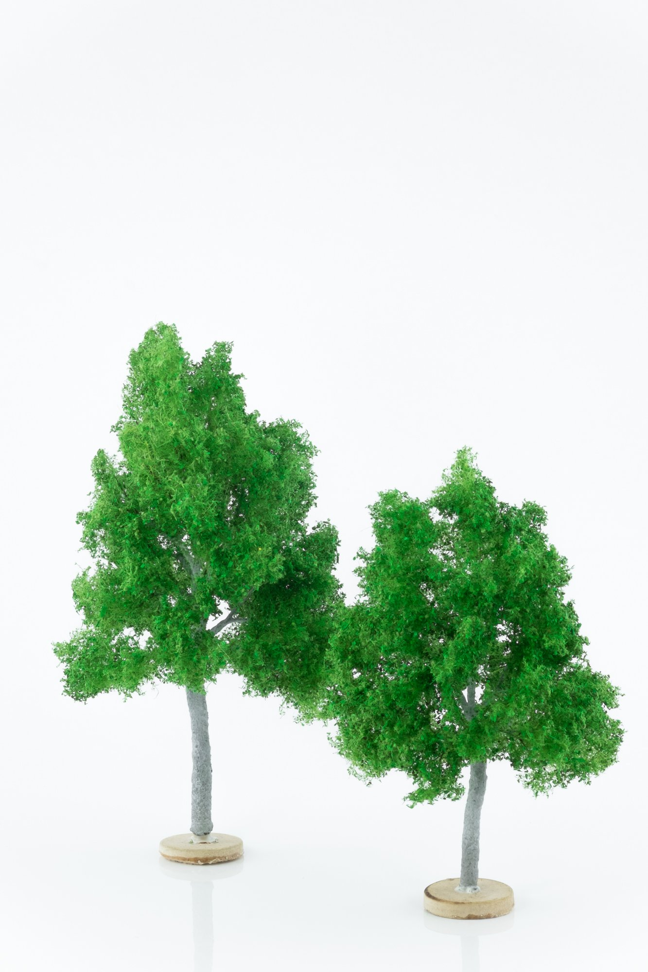 Two, green, maple model trees. Size from 14 to 20 cm. Made from high quality model supplies by Primo Models.