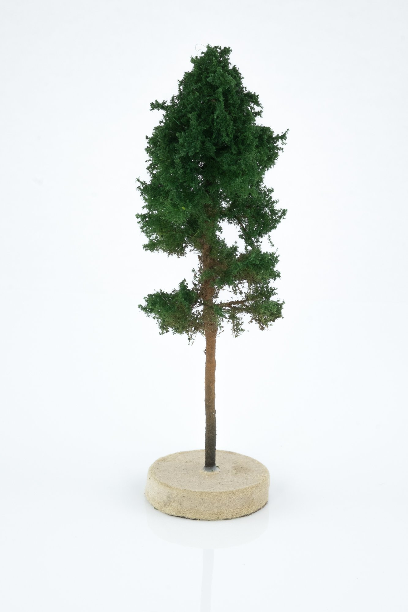 Hand-made, green, pine tree model. Size between 8 and 12 cm. Made from high quality model supplies by Primo Models.