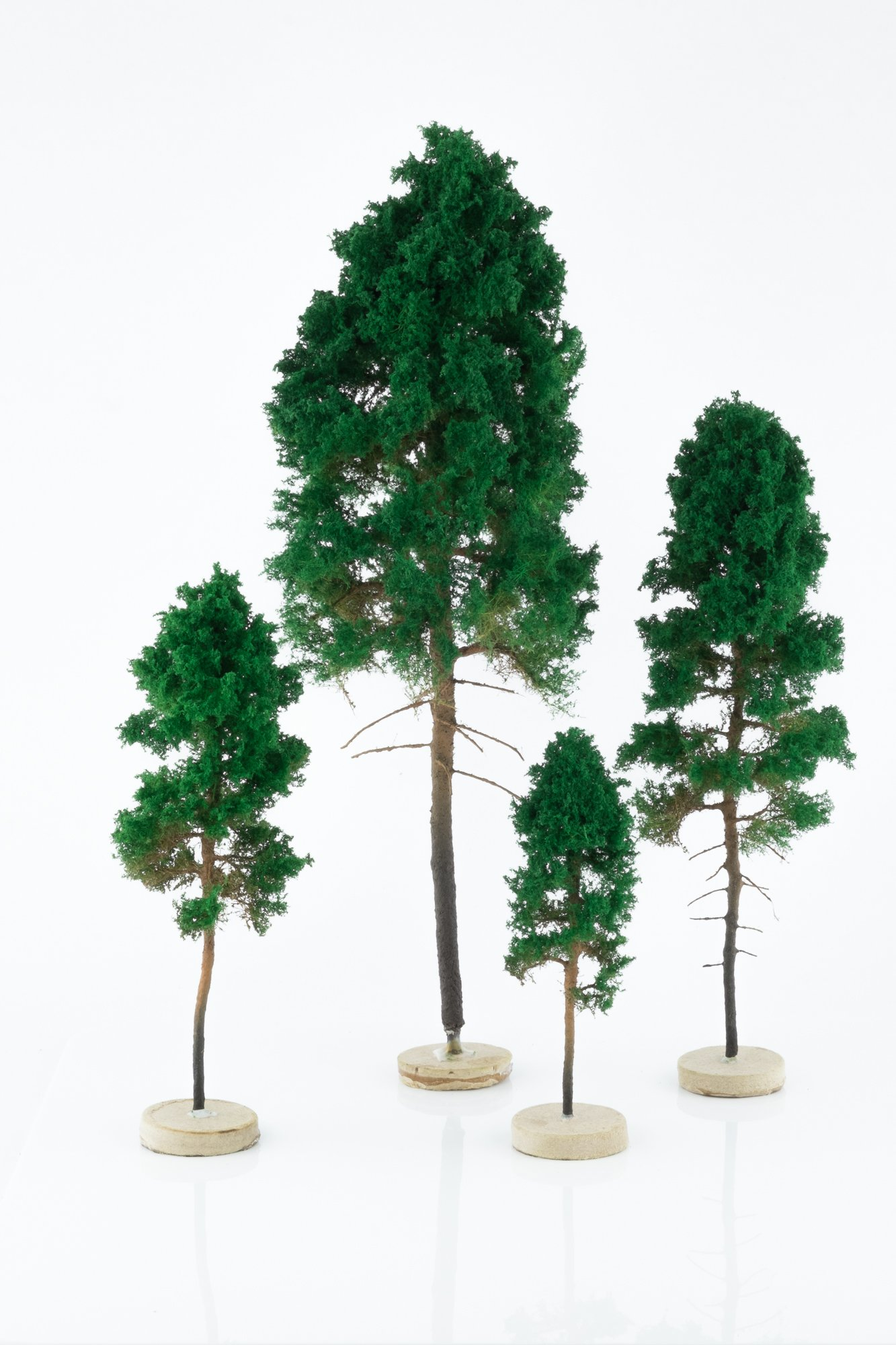 Four, green, pine model trees. Size from 8 to 28 cm. Made from high quality model supplies by Primo Models.