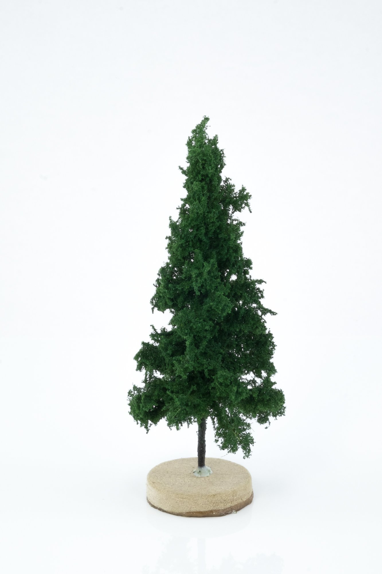 Hand-made, green, spruce tree model. Size between 8 and 12 cm. Made from high quality model supplies by Primo Models.