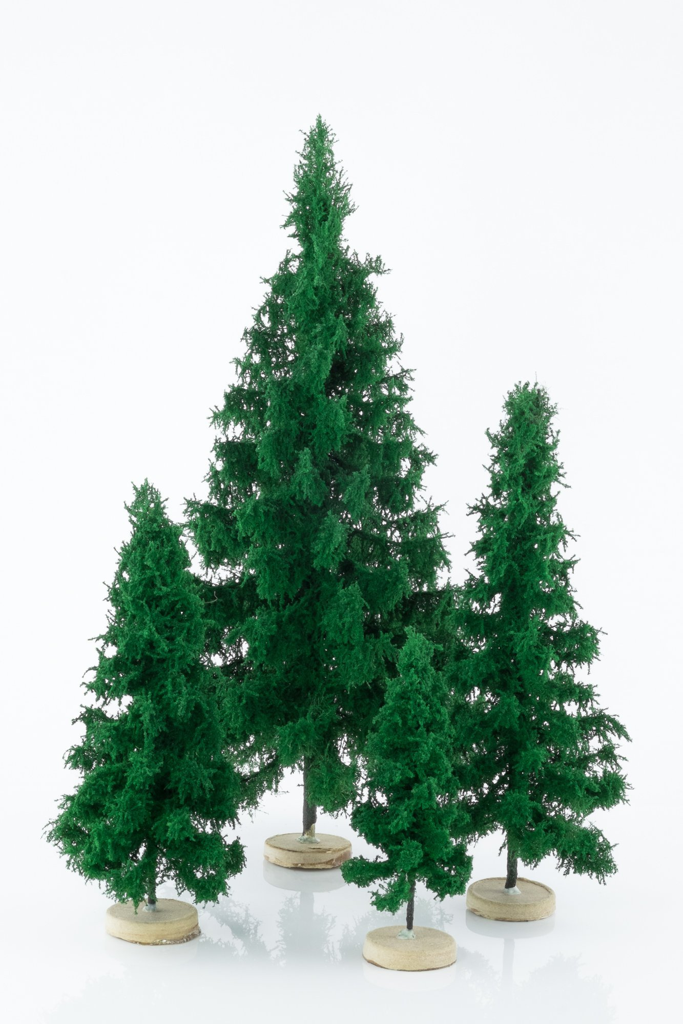 Four, green, spruce model trees. Size from 8 to 28 cm. Made from high quality model supplies by Primo Models.