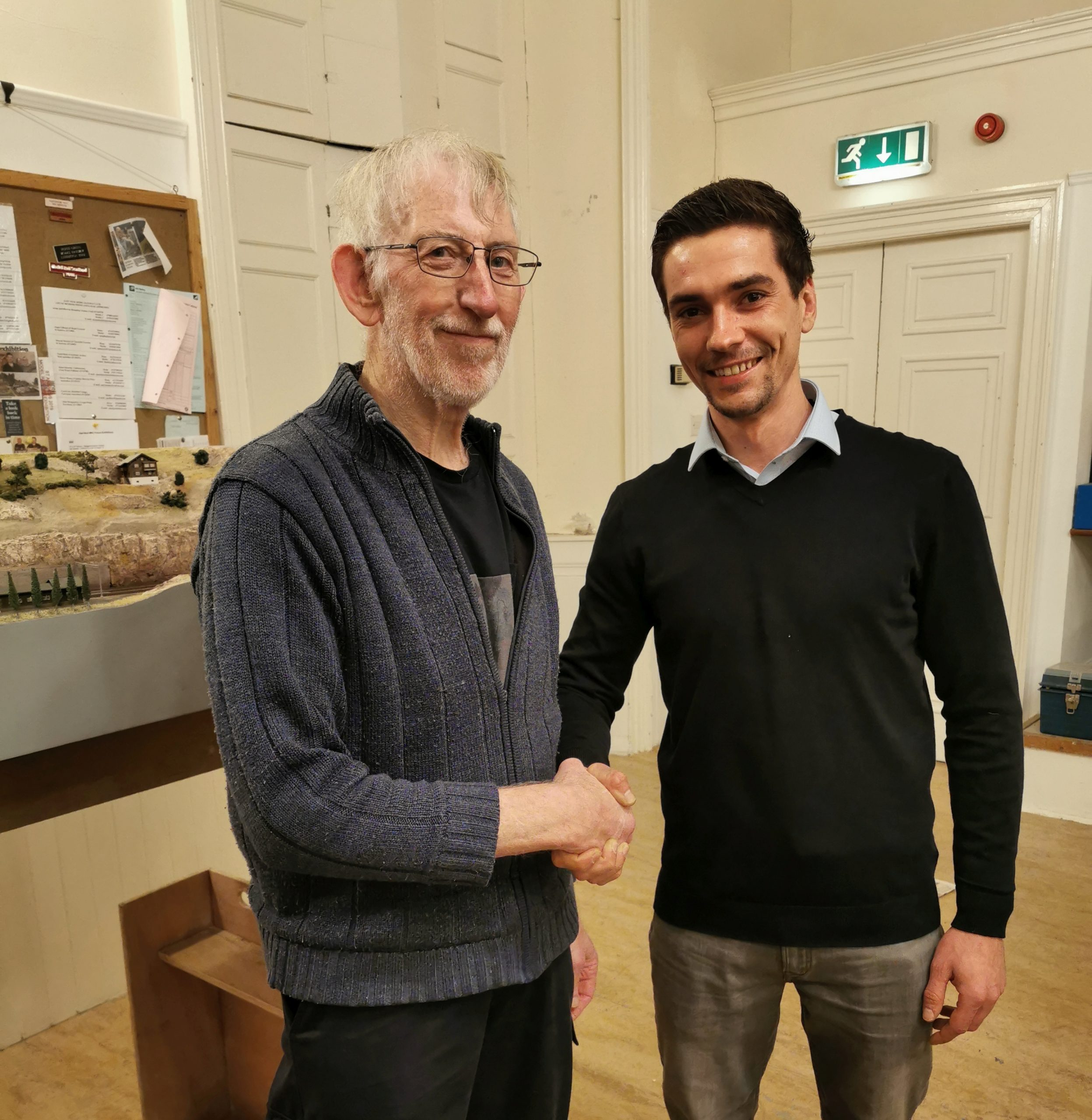 Primo models director shaking hand with the East Neuk Club chariman.