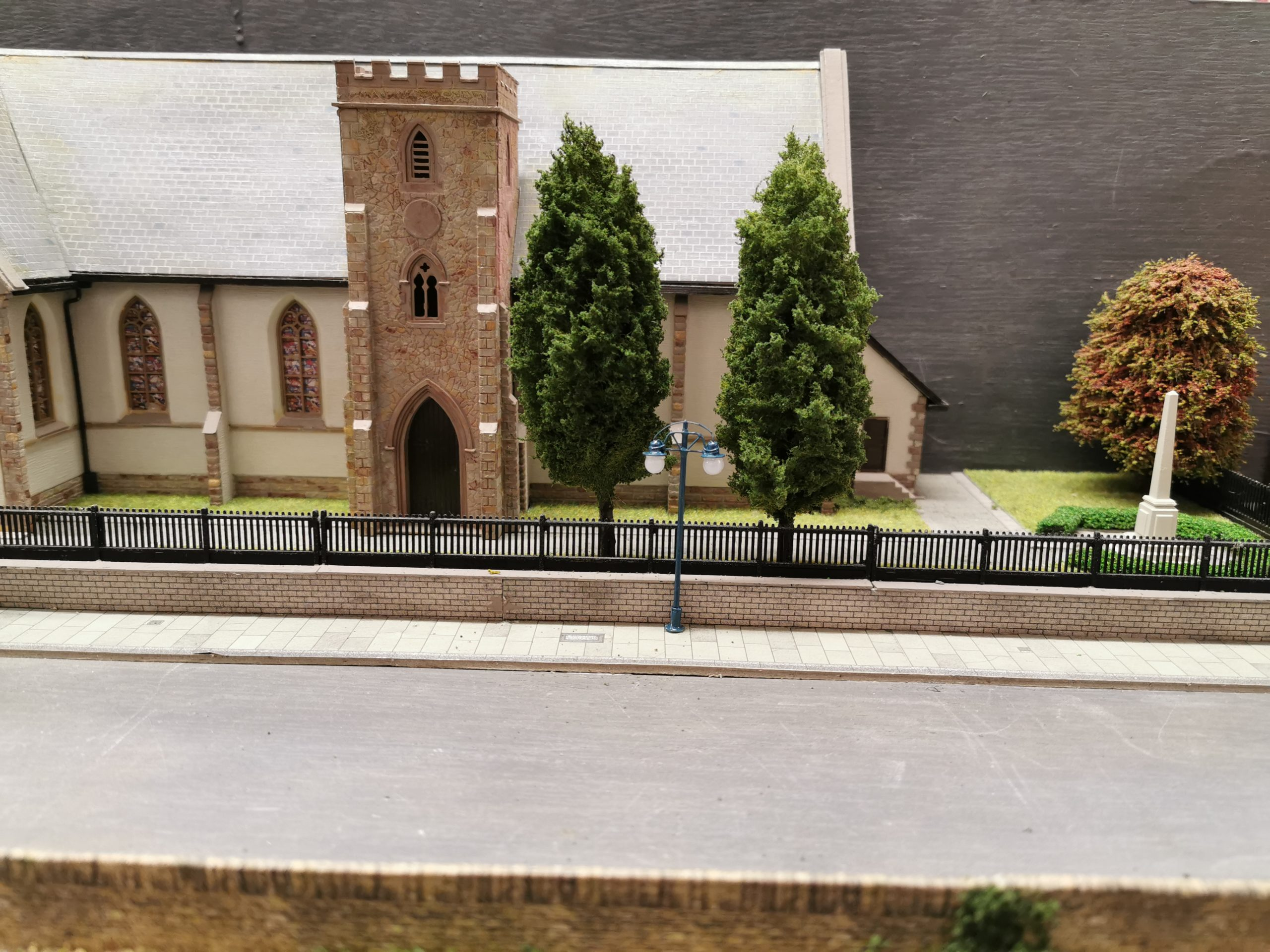 Primo Models trees on the layout of Glenrothes Model Railway Club next to church