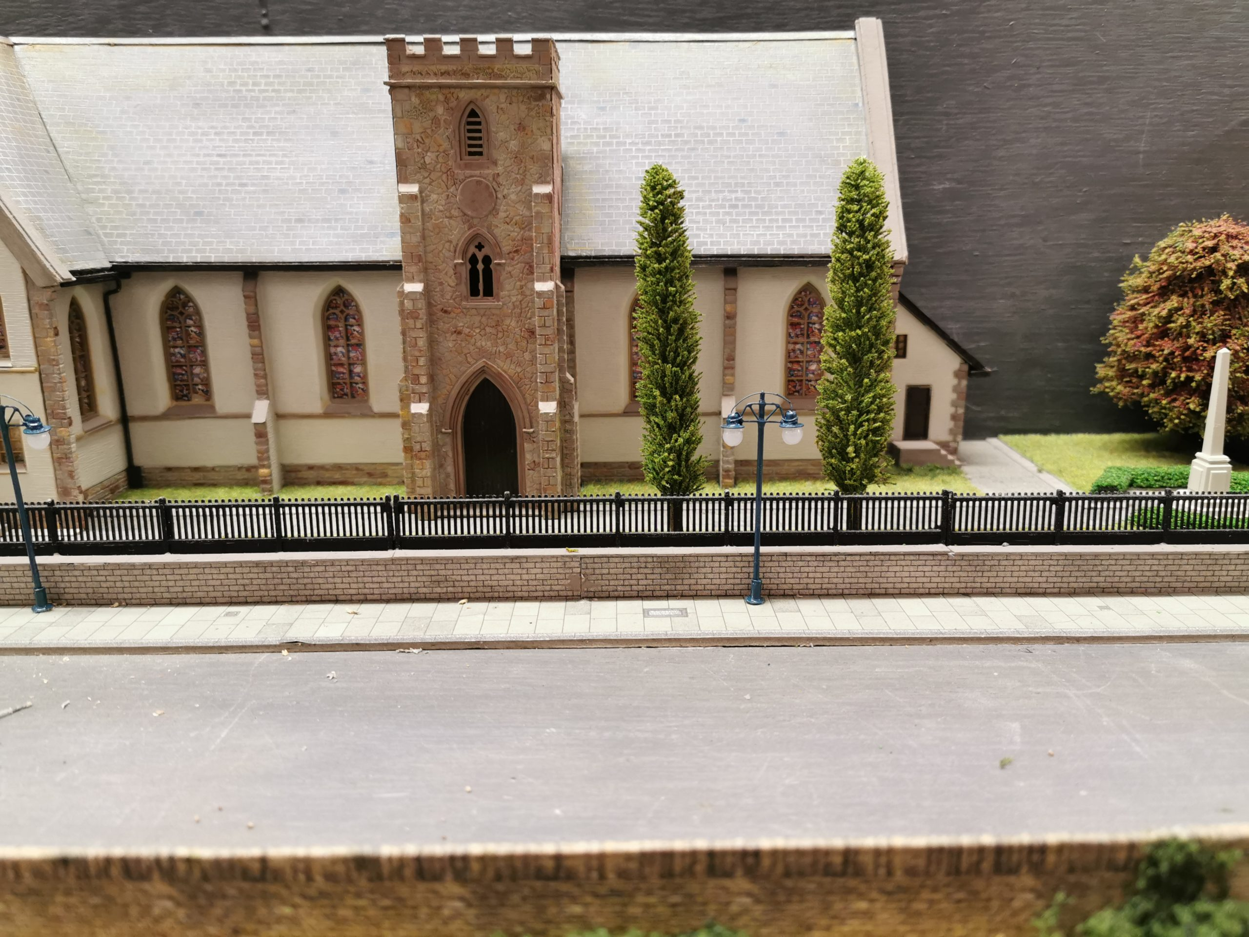Model trees on the layout of Glenrothes Model Railway Club next to church