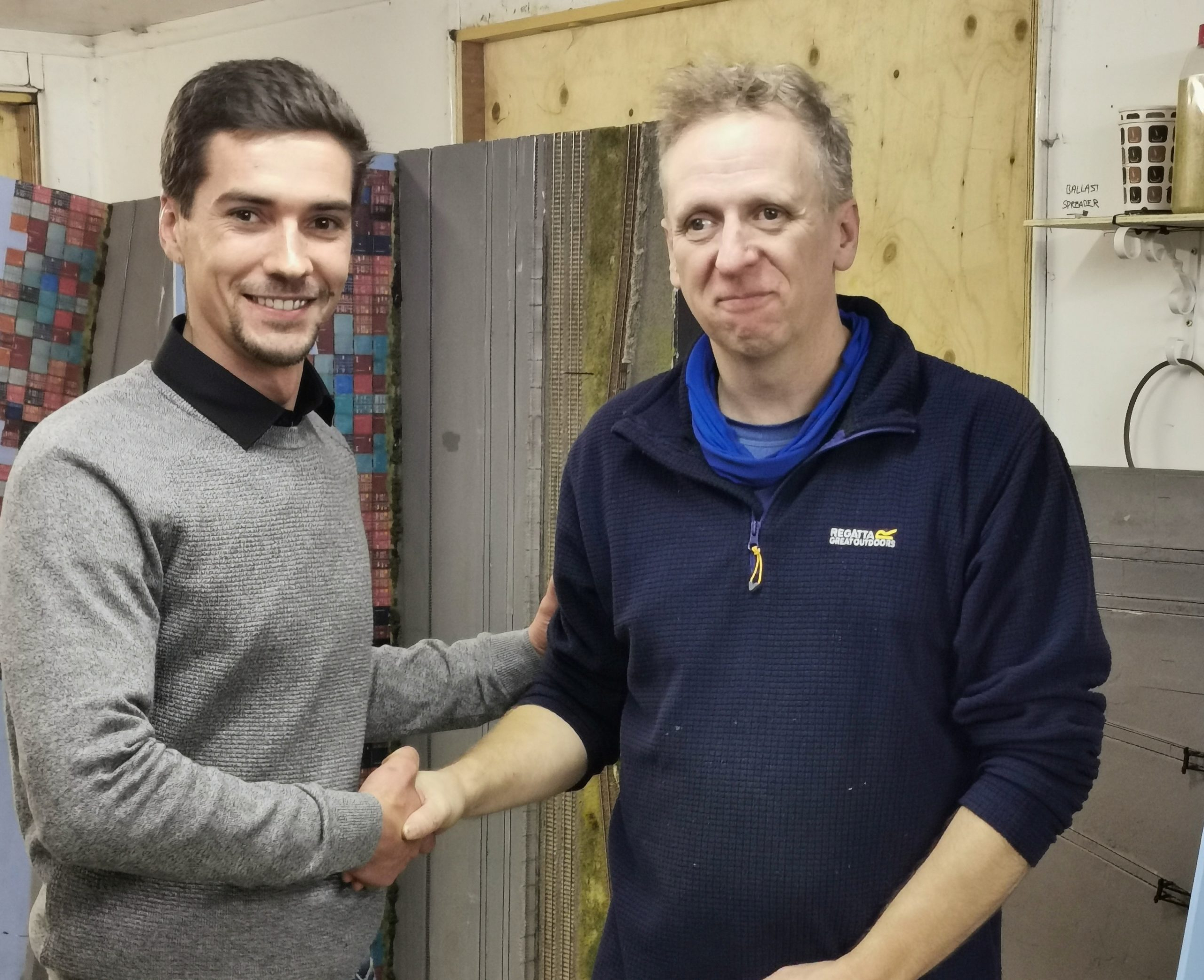 Primo models director shaking hand with the Aberdeen club secretary