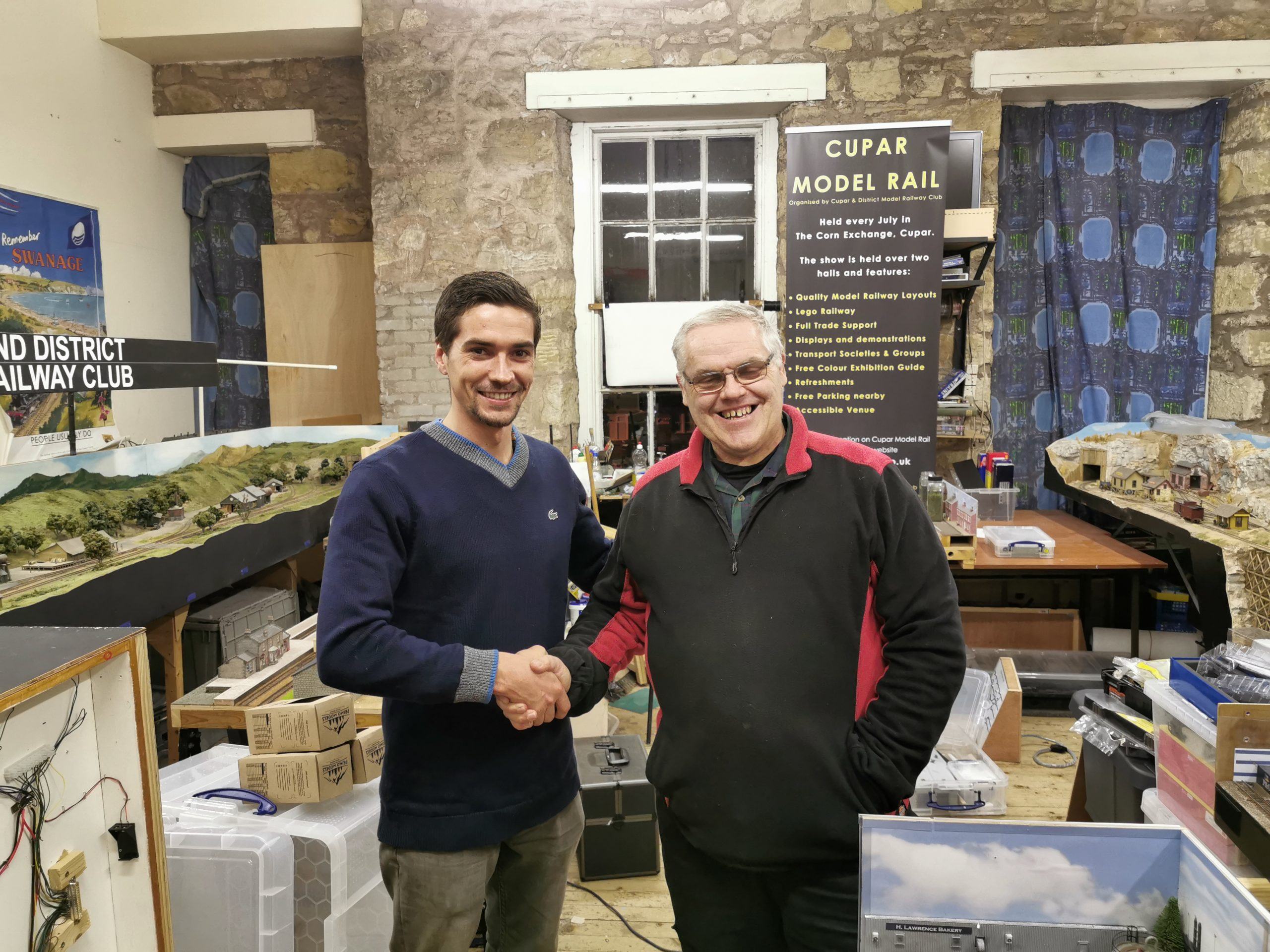 Primo Models director shaking hand with the Cupar Club Chariman