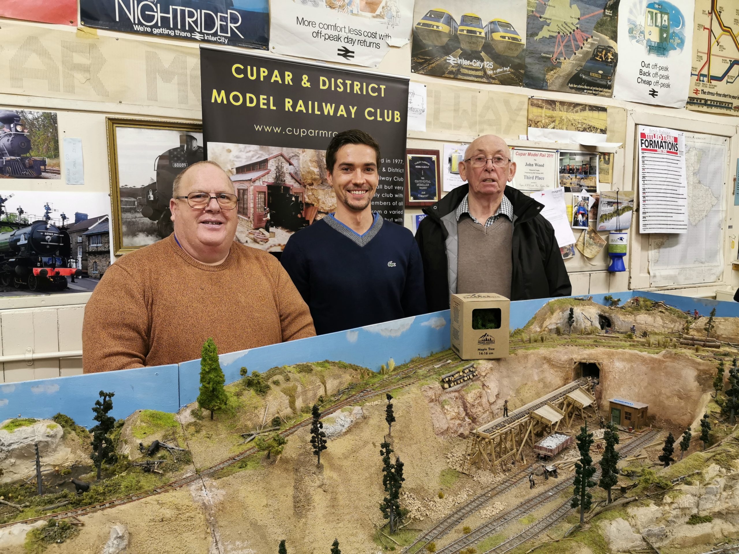 Cupar Model Railway Club members next to layout in O scale